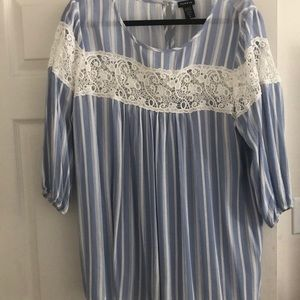 Light blue long sleeve blouse with design